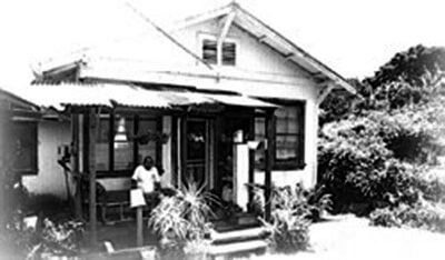 Interviewee Stanley Mendes sits on porch of his plantation house, Honoka'a, Hawai'i, 1996. (COH photo.)