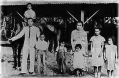 Labrador family at Stable Camp, Koloa, ca. 1935. Andres Labrador was responsible for the care of horses and mules used on the plantation. (Photo courtesy Andres Labrador.)