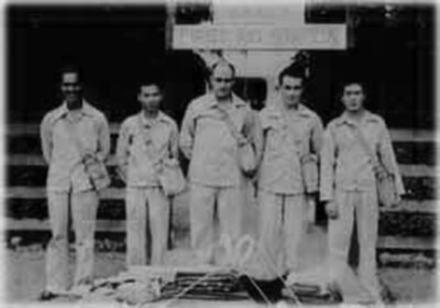 Interviewee Hisao Kimura, second from left, and other first aid squad members, stand in front of the Waimea First Aid Station, ca. 1942. (Photo courtesy Kimura family.)