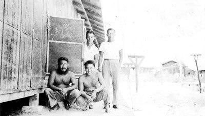 Mr. Tanaka, Interviewee Mr. Nakamura (front); Mr. Uyeda and Mr. Ono (back), Poston Relocation Camp, Block 14, 1942. (Photo courtesy Charles Nakamura.)
